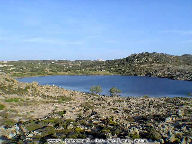 The panoramic view of Achivadolimni. Splendid, very big sandy beach. In the small lake, that loses almost all the water in August, is owed also the name of beac