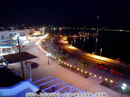 The port of Adamas at night
